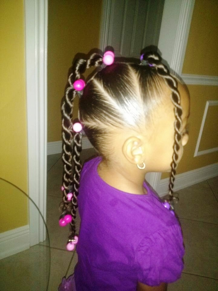 little girl braided ponytails with beads