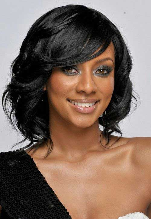 Black Short wavy curly layered hairstyle