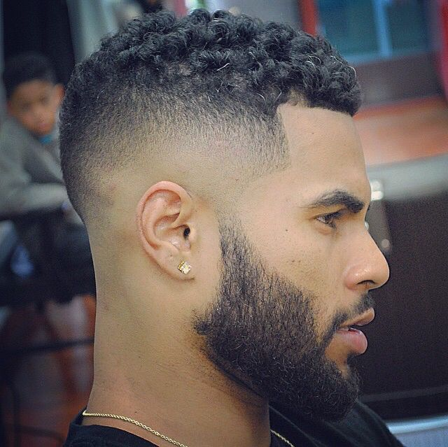 Side shaved hairstyle for boys curly hair